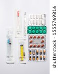 pills  syringe and thermometer... | Shutterstock . vector #1555769816