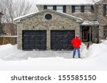 Man Clearing Snow On His...