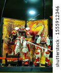 """Small photo of """"Klang, Malaysia- Circa November, 2019: A picture of Bandai Gundam Astray Red miniature collection display on the cabinet."""""""