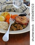 Small photo of Veal roulade with vegetables in a plate close up