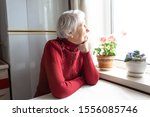 Old Lonely Woman Sitting Near...