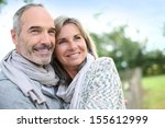 cheerful senior couple enjoying ... | Shutterstock . vector #155612999