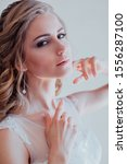 Small photo of girl bride in a white dress wedding dress beautiful