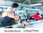 indonesian worker using a... | Shutterstock . vector #155647994