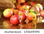 Basket Of Apples On A Wet Table