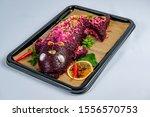 Stock photo herring fillet under beet root mash and mayonnaise coating 1556570753