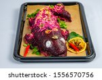 Stock photo herring fillet under beet root mash and mayonnaise coating 1556570756