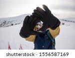 A Skier In Warm Black Gloves ...