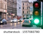 Small photo of A city crossing with a semaphore. Green light in semaphore - image