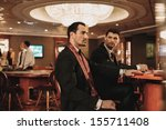 two young men in suits behind... | Shutterstock . vector #155711408