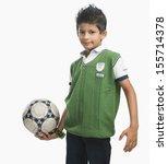portrait of boy holding soccer... | Shutterstock . vector #155714378