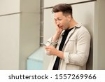surprised young man with mobile ... | Shutterstock . vector #1557269966