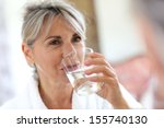 senior woman drinking water in... | Shutterstock . vector #155740130