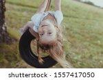 Happy Girl Swinging On A Wheel  ...