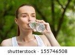 thirsty woman drinking fresh... | Shutterstock . vector #155746508