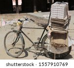 Old Bike With Cardboard Tied...