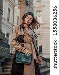 outdoor autumn fashion portrait ...   Shutterstock . vector #1558036256