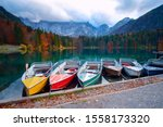 Alpine Lake And Colorful Boats...