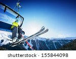 skier on lift in mountains | Shutterstock . vector #155844098