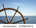 Ship Wheel And Blue Sea On...