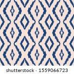 ikat geometric folklore... | Shutterstock .eps vector #1559066723