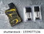 Small photo of Vape pod system or pod mod with changeable cartridges close up - newest generation of vaping products - small size devices for inhaling higher nicotine strengths.