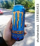 Small photo of Krakow, malopolskie / Poland - 21/09/2019: Monster Mango Loco Juiced energy drink on the human hand