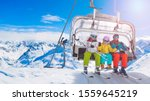Happy Family On Ski Lift Chair...