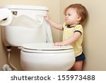 Ornery Baby Pulling Toilet...