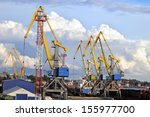 port cranes against the blue... | Shutterstock . vector #155977700