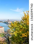 Autumn skyline of Budapest, Hungary with fall trees in the foreground. Hungarian Parliament Building, Orszaghaz, in the background on the other side of the Danube river. Hungarian capital city.
