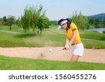 Woman Golfer Hit Sand Ground...