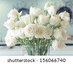 Stock photo white roses flower arrangement in a glass vase 156066740