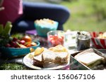 picnic food laid out on blanket | Shutterstock . vector #156067106