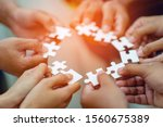 Team work, hands and jig Saw Unite with power Is a good team of successful people Team work concept - stock photo