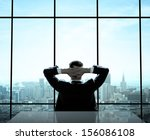 relaxed man sitting in office | Shutterstock . vector #156086108