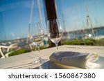 glasses of wine on a table in a ...   Shutterstock . vector #1560867380
