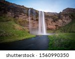 Seljalandsfoss waterfall long exposure during a bright sunny day in Iceland - stock photo