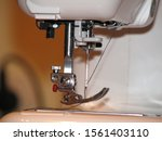 Small photo of Needle and thread in a sewing machine