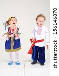 little boy and girl in folk... | Shutterstock . vector #156146870