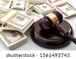 Small photo of Money influence in the legal court system, corruption, auction bidding and bankruptcy conceptual idea with wood judge gavel and wad or bundle of cash on white background