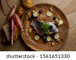 Stock photo  russian style pickled salted herring with boiled potatoes fresh onions and brown bread on a 1561651330