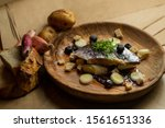 Stock photo  russian style pickled salted herring with boiled potatoes fresh onions and brown bread on a 1561651336