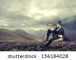 elegant man with cylinder looks ...   Shutterstock . vector #156184028