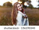 Young Smiling Woman In Autumn...