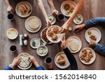Group Of Mexican People Eating...