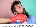 Hand In Boxing Glove Punching...