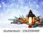 Christmas Lantern On Snow With...