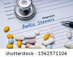Small photo of Aortic Stenosis Diagnosis Written On A Form With Stethoscope, Pen And Pills