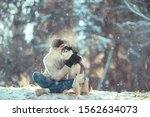 Young Man Hugs A Husky Dog In...